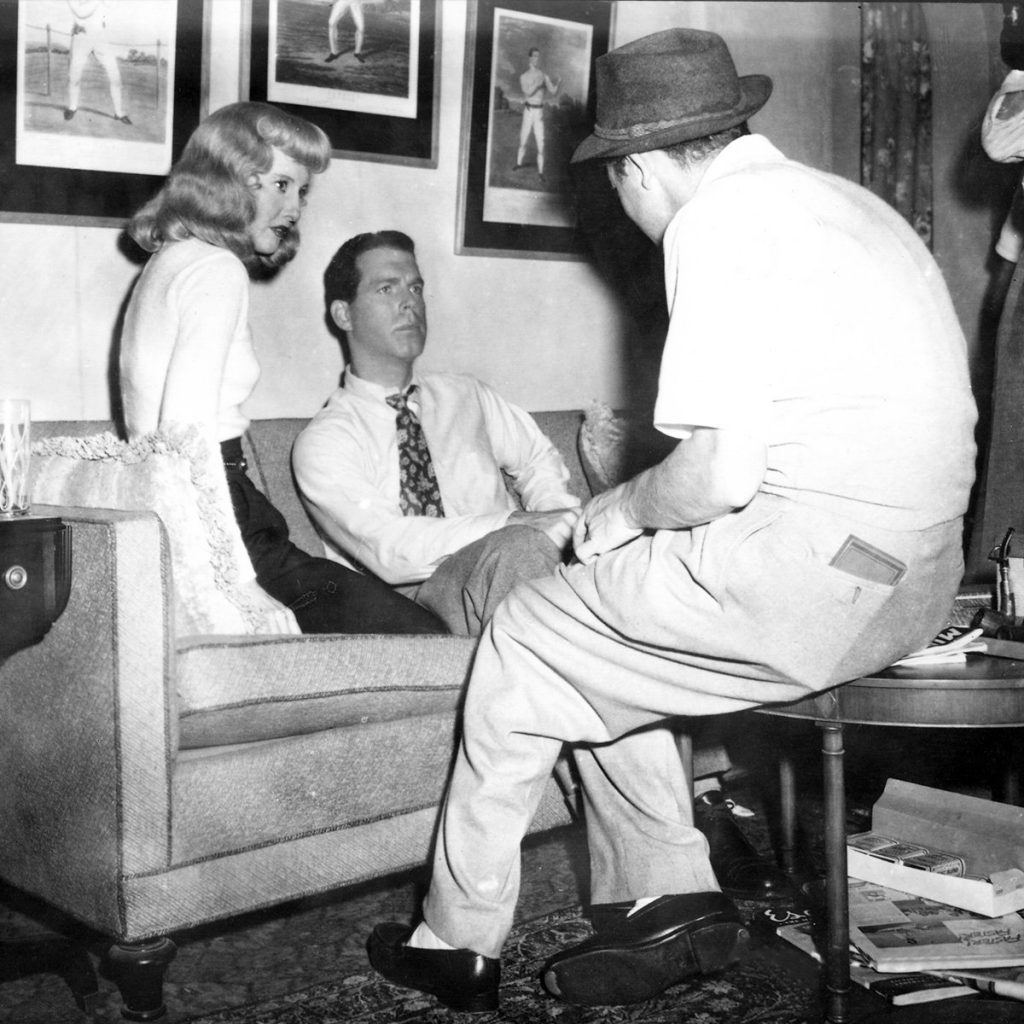 Billy Wilder directs Barbara Stanwyck and Fred MacMurray in Double Indemnity (1944)