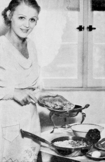 Gloria Stuart shown cooking at her home in the January 1933 issue of Photoplay magazine.