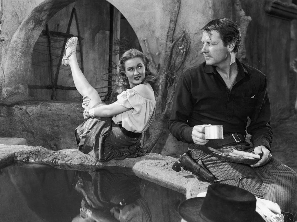 Joel McCrea and Virginia Mayo in a scene from Colorado Territory (1949)