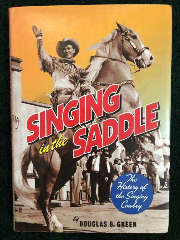 Singing in the Saddle: The History of the Singing Cowboy by Douglas B. Green