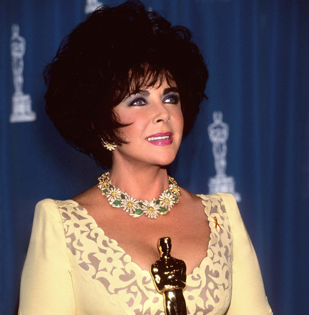 Elizabeth Taylor in 1993 with her Jean Hersholt Humanitarian Award, which she received for her efforts to fight AIDS during her final decades.