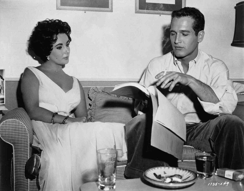 Elizabeth Taylor and Paul Newman on the set of Cat on a Hot Tin Roof (1958).