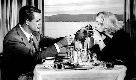 cary grant and eva marie saint, north by northwest, train dining car, lighting a cigarette