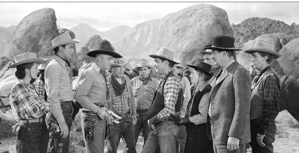 "Hopalong Cassidy and cast in a scene from ""In Old Colorado"", 1941. William Boyd (third from left, black hat) played Hopalong Cassidy in 66 theatrical features between 1935 and 1948, and more than a third of them were shot in the Alabama Hills near Lone Pine California."