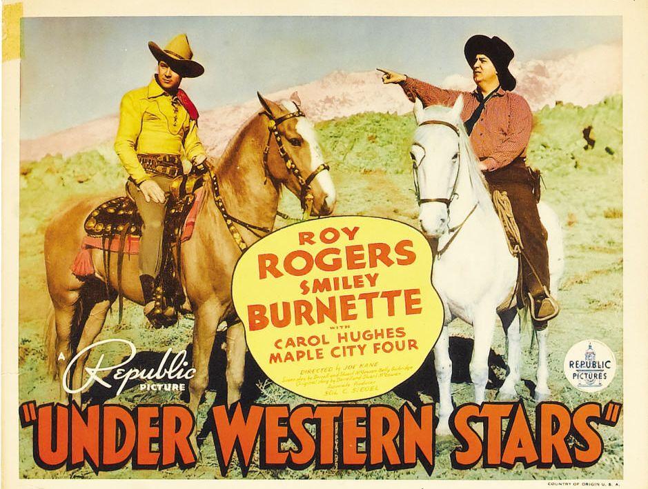 Roy Rogers & Smiley Burnette in Under Western Stars (1938)