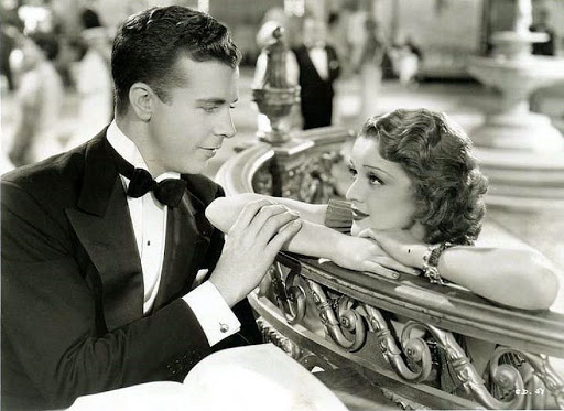 Dick Powell and Dorothy Dare in Happiness Ahead (1934)
