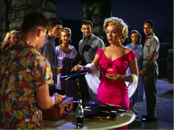 Marilyn Monroe in Niagara, shocking pink dress, with a vinyl record