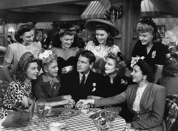 Joel McCrea surrounded by women in The More The Merrier (1943)