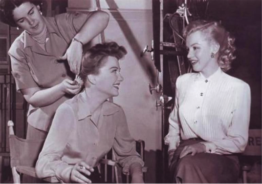 Anne Baxter and Marilyn Monroe on the set of All About Eve