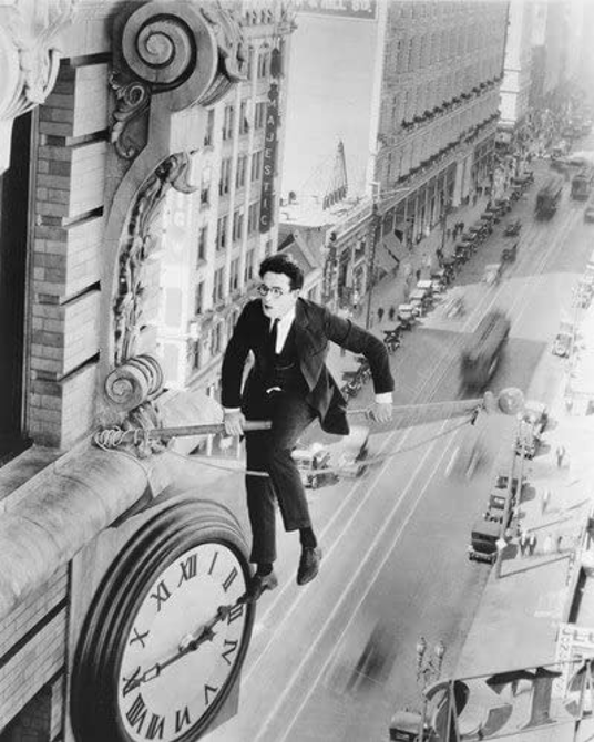 Harold Lloyd Safety Last! (1923) balancing on clock pole