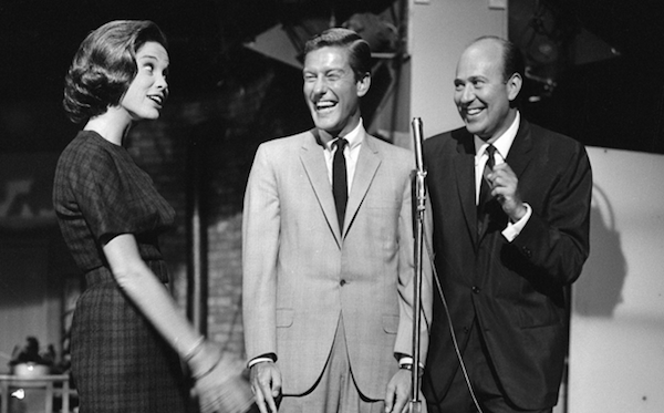 Reiner would do audience warm-up before the taping of The Dick Van Dyke Show. Here he is with Dick Van Dyke and Mary Tyler Moore, 1962