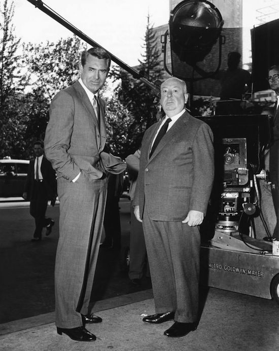 NORTH BY NORTHWEST, from left: Cary Grant, director Alfred Hitchcock on location in New York on set, 1959