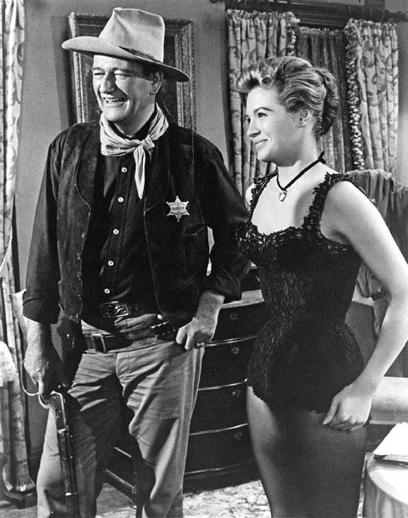 "John Wayne as Sheriff Chance & Angie Dickinson as ""Feathers"" in Rio Bravo (1959)"