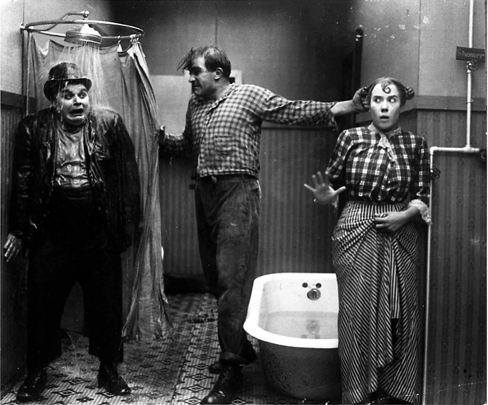 Roscoe Arbuckle, Edgar Kennedy, and Louise Fazenda in Fatty's Tintype Tangle (1915)