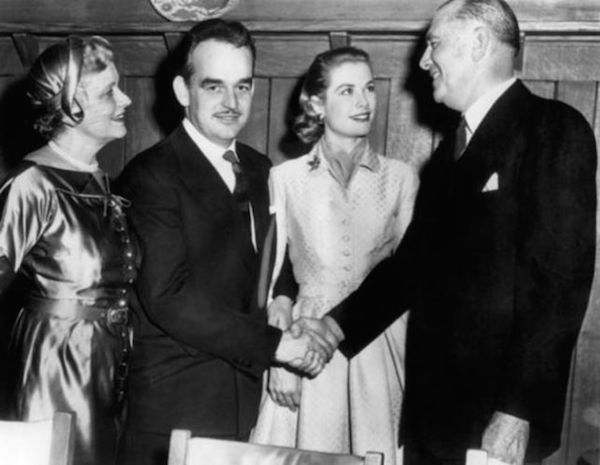 Grace Kelly, her parents and Rainier during the engagement announcement