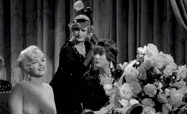 Some Like It Hot Marilyn Monroe Jack Lemmon Tony Curtis handing flowers to Monroe