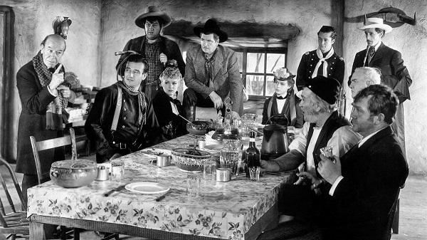 John Wayne, John Carradine, George Bancroft, Berton Churchill, Andy Devine, Francis Ford, Tim Holt, Donald Meek, Thomas Mitchell, Louise Platt, and Claire Trevor in Stagecoach (1939)