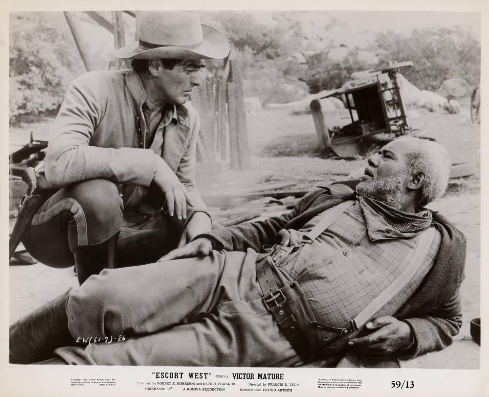 Victor Mature and Rex Ingram in Escort West (1958)
