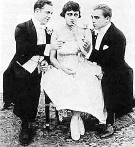 Gloria Swanson with Reggie Morton and Bobby Vernon in A Social Club (1916).