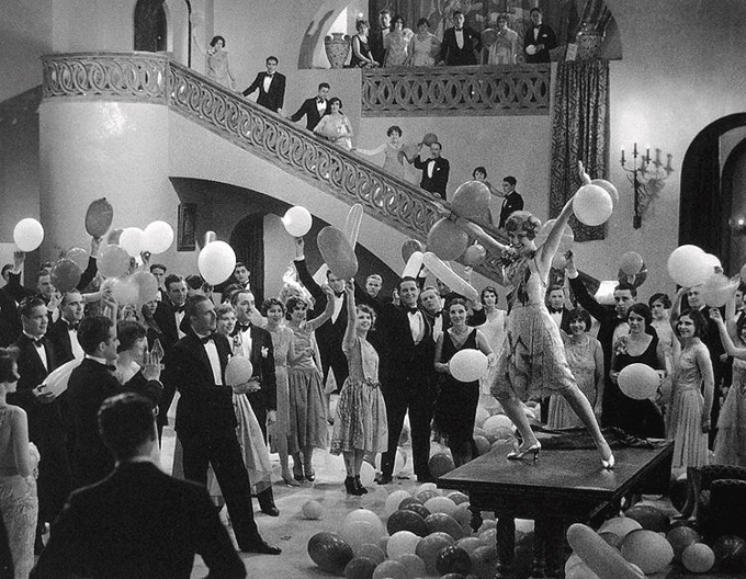 """Joan Crawford dancing the """"Charleston"""" on a table in Our Dancing Daughters (1928)"""