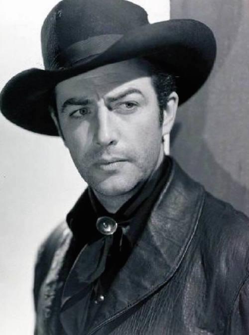 Robert Taylor as the title character in Billy the Kid 1941